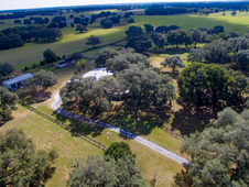 FLY-IN EQUINE ESTATE 62 AC, 17 STALLS