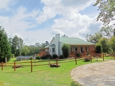 13+ acres 4 bedroom 2 bath, pond, pool and workshope