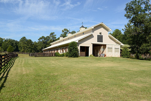 Reduced! An Equestrian Oasis behind gated entry